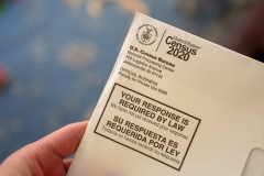 Close-up of human hand holding a letter from the Census Bureau regarding the 2020 Census, San Ramon, Calif. (Photo credit: Smith Collection/Gado/Getty Images)