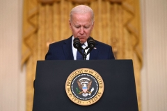 President Joe Biden pauses as he delivers remarks on the terror attack at Hamid Karzai International Airport, and the US service members and Afghan victims killed and wounded, in the East Room of the White House, Washington, DC on August 26, 2021. - The 12 US military troops killed in the bombing attack on Kabul airport Thursday amounted to the worst single-day loss for the Pentagon in Afghanistan since 2011. (Photo by JIM WATSON/AFP via Getty Images)