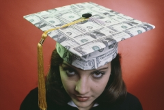 A female graduate wears a cap made of one-dollar banknotes. (Photo credit: Alfred Gescheidt/Getty Images)