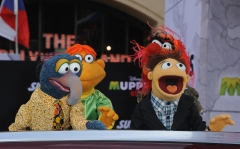 """Muppet characters The Great Gonzo, Scooter, Walter and Animal arrive for Disney's """"Muppets Most Wanted"""" Los Angeles Premiere at the El Capitan Theatre. (Photo credit: Steve Granitz/WireImage)"""