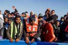Migrants from Afghanistan and other countries rescued during a bid to cross the Mediterranean by small boat from North Africa last year. (Photo by Pablo Garcia/AFP via Getty Images)