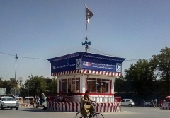 A Taliban flag flies atop a booth in the main square of the provincial capital of Kunduz, captured by the jihadists at the weekend. (Photo by AFP via Getty Images)