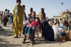 Stranded Afghans wait for the reopening of the Pakistan-Afghanistan border crossing point which was closed on August 12, 2021, after the Taliban took control of the Afghan border town in a rapid offensive across the country. (Photo by STRINGER/AFP via Getty Images)