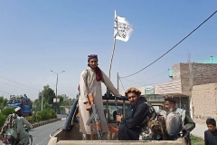 Taliban fighters drive an Afghan National Army vehicle through the streets of Laghman province on August 15, 2021. (Photo by -/AFP via Getty Images)