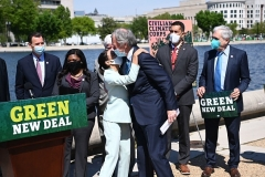 Rep. Alexandria Ocasio-Cortez (D-N.Y.) embraces Sen. Ed Markey, (D-Mass), after re-introducing the Green New Deal on April 20, 2021. (Photo by MANDEL NGAN/AFP via Getty Images)