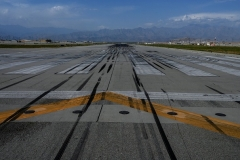 The runway at the Bagram air base where Americans and desperate Afghanis are waiting for flights out of the disintegrating country, now under Taliban control. (Photo by WAKIL KOHSAR/AFP via Getty Images)