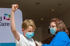 A 13-year-old Connecticut boy gets his COVID vaccination. (Photo by JOSEPH PREZIOSO/AFP via Getty Images)