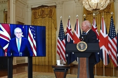 President Biden watches as Australian Prime Minister Scott Morrison speaks during Wednesday's joint announcement. British Prime Minister Boris Johnson, out of frame, also participated by video link. (Photo by Brendan Smialowski / AFP via Getty Images)