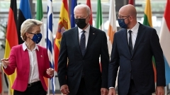 President Biden received a warm welcome from European Council President Charles Michel and E.U. Commission President Ursula von der Leyen in Brussels last June.  (Photo by Brendan Smialowski/AFP via Getty Images)