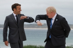 British Prime Minister Boris Johnson and French President Emmanuel Macron at a G7 summit in Cornwall, England last June. (Photo by Ludovic Marin/AFP via Getty Images)