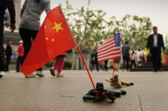 Pictured are Chinese and American toy soldiers. (Photo credit: PETER PARKS/AFP/GettyImages)
