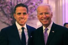 Joe Biden poses with son Hunter. (Photo credit: Teresa Kroeger/Getty Images)