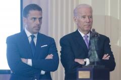 Joe Biden stands with son, Hunter Biden. (Photo credit: Kris Connor/WireImage)