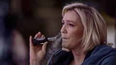 Marine Le Pen, president of France's National Rally party, smokes an e-cigarette. (Photo credit: Horacio Villalobos - Corbis/Corbis via Getty Images)