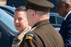 After stepping down as commander of U.S. forces in Afghanistan in mid-July, U.S. Army Gen. Scott Miller is greeted at Andrews Air Force Base, Md. by Defense Secretary Gen. Lloyd Austin and chairman of the Joint Chiefs of Staff Gen. Mark Milley.  (Photo by Alex Brandon/ Pool/AFP via Getty Images)