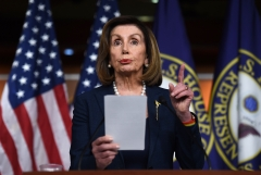 House Speaker Nancy Pelosi (D-CA) gives a speech. (Photo credit: OLIVIER DOULIERY/AFP via Getty Images)