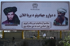 A billboard in Kabul features large pictures of the late Taliban founder Mohammed Omar and the late Haqqani Network founder Jalaluddin Haqqani. (Photo by Aamir Qureshi/AFP via Getty Images)
