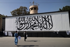 A large Taliban flag, bearing in Arabic the words 'There is no god but Allah and Mohammed is his messenger,' has been painted on a wall outside the U.S. Embassy compound in Kabul. (Photo by Karim Sahib/AFP via Getty Images)