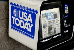 Featured is a USA Today newspaper stand. (Photo credit: Francis Dean/Corbis via Getty Images)