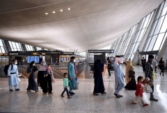 Afghan refugees arrive at Dulles International Airport on August 27, 2021 in Chantilly, Virginia after being evacuated from Kabul following the Taliban takeover of Afghanistan. (Photo by OLIVIER DOULIERY/AFP via Getty Images)