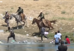 (Screen capture of CBP agents on horseback trying to deter influx of Haitian migrants.)