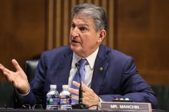 """Sen. Joe Manchin (D-W.Va) is the pivotal vote on the Democrats' massive """"human"""" infrastructure (entitlement) bill. He said he's in no rush to pass it. (Photo by OLIVER CONTRERAS/POOL/AFP via Getty Images)"""