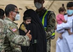 Both here and overseas, the U.S. military is housing tens of thousands of Afghan evacuees who are not yet vetted. (Photo by ARMANDO BABANI/AFP via Getty Images)