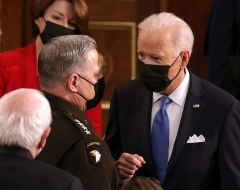 President Joe Biden speaks with the Chairman of the Joint Chiefs of Staff Gen. Mark A. Milley after addressing Congress on April 28, 2021. (Photo by CHIP SOMODEVILLA/POOL/AFP via Getty Images)
