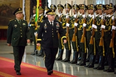 China's People's Liberation Army (PLA) General Li Zuocheng and then-US Army Chief of Staff General Mark Milley review an honor guard during a welcome ceremony in Beijing on August 16, 2016. (Photo by MARK SCHIEFELBEIN/AFP via Getty Images)
