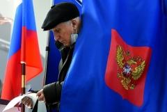 A Russian voter in Saint Petersburg on Sunday. (Photo by Olga Maltseva/AFP via Getty Images)