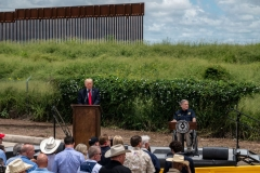 Former US President Donald Trump (L) speaks, flanked by Texas Governor Greg Abbott, during a visit to the border wall near Pharr, Texas on June 30, 2021. - Former President Donald Trump visited the area with Texas Gov. Greg Abbott to address the surge of unauthorized border crossings that they blame on the Biden administration's change in policies. (Photo by SERGIO FLORES/AFP via Getty Images)
