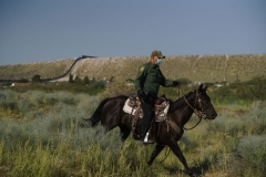 A United States Border Patrol Agent patrols on horseback on the U.S.-Mexico border in Sunland Park, New Mexico on September 9, 2021. (Photo by PAUL RATJE/AFP via Getty Images)