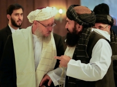 The Taliban's 'acting' deputy prime minister Abdul Salam Hanafi, left, speaks to 'acting' Foreign Minister Amir Khan Muttaqi in Moscow on Wednesday. (Photo by Alexander Zemlianichenko / Pool / AFP via Getty Images)