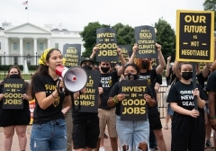 Sunrise Movement climate activists protest in front of the White House in June. (Photo by Saul Loeb/AFP via Getty Images)