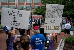 """Parents rally against """"critical race theory"""" being taught in Loudoun County, Va. schools on June 12, 2021. (Photo by ANDREW CABALLERO-REYNOLDS/AFP via Getty Images)"""