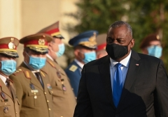 Defense Secretary Lloyd Austin reviews a military honour guard during an official welcoming ceremony at the Romanian Defence Ministry's headquarters in Bucharest, Romania, on October 20, 2021. (Photo by DANIEL MIHAILESCU/AFP via Getty Images)