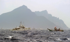 A Taiwan fishing boat is blocked by a Japan Coast Guard  vessel near the disputed Diaoyu/Senkaku islands in the East China Sea on September 25, 2012. (Photo by SAM YEH/AFP/GettyImages)