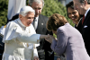 Speaker Nancy Pelosi kisses the ring of Pope Benedict XVI on the South Lawn of the White House, April 16, 2008. (Getty Images/Chip Somodevilla)