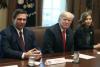 President Trump with Florida Gov. Ron DeSantis and South Dakota Gov. Kristi Noem. (Photo by Mark Wilson/Getty Images)