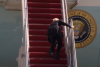 President Joe Biden stumbles a few times on his way up the steps on March 19, 2021. (Photo: Screen capture)