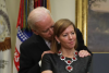 Then-Vice President Joe Biden leans into Stephanie Carter, wife of then-Defense Secretary Ashton Carter who was speaking at the White House. (Photo by Alex Wong/Getty Images)