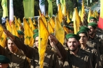 Hezbollah fighters near Sidon, Lebanon, last month. (Photo by Mahmoud Zayyat/AFP via Getty Images)