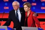 Democratic presidential candidates Sens. Elizabeth Warren and Bernie Sanders at a debate in Detroit last July. (Photo by Brendan Smialowski/AFP via Getty Images)