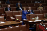 House Speaker Nancy Pelosi uses a white disinfectant cloth to wipe down the microphone on the Democratic side of the House chamber, March 27, 2020. (Screen Capture)