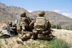 U.S. soldiers scan a hillside in Afghanistan's Wardak province last June. (Photo by Thomas Watkins/AFP via Getty Images)