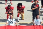 Colin Kaepernick (#7) and Eric Reid (#35) kneel during the national anthem before a game between the 49ers and Carolina Panther in Charlotte, North Carolina, Sept. 18, 2016. (Photo by Grant Halverson/Getty Images)