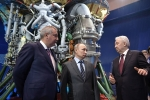 Russian President Vladimir Putin and Roscosmos head Dmitry Rogozin, left, visit a Russian rocket engine manufacturer outside Moscow in April last year. (Photo by Alexey Nikolsky/AFP via Getty Images)