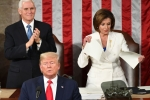 S Vice President Mike Pence claps as Speaker of the US House of Representatives Nancy Pelosi appears to rip a copy of US President Donald Trump's speech after he delivers the State of the Union address at the US Capitol in Washington, DC, on February 4, 2020. (Photo by MANDEL NGAN/AFP via Getty Images)