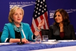 Center for American Progress President Neera Tanden is pictured with former Secretary of State Hillary Clinton. (Photo credit: Paul Morigi/WireImage)