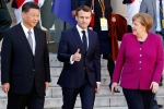 Chinese President Xi Jinping, French President Emmanuel Macron, and German Chancellor Angela Merkel in Paris in 2019. (Photo by Chesnot/Getty Images)